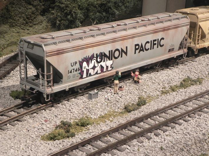 Figure 3 Unfinished Graffiti on a Hopper Car Across from the Modern City