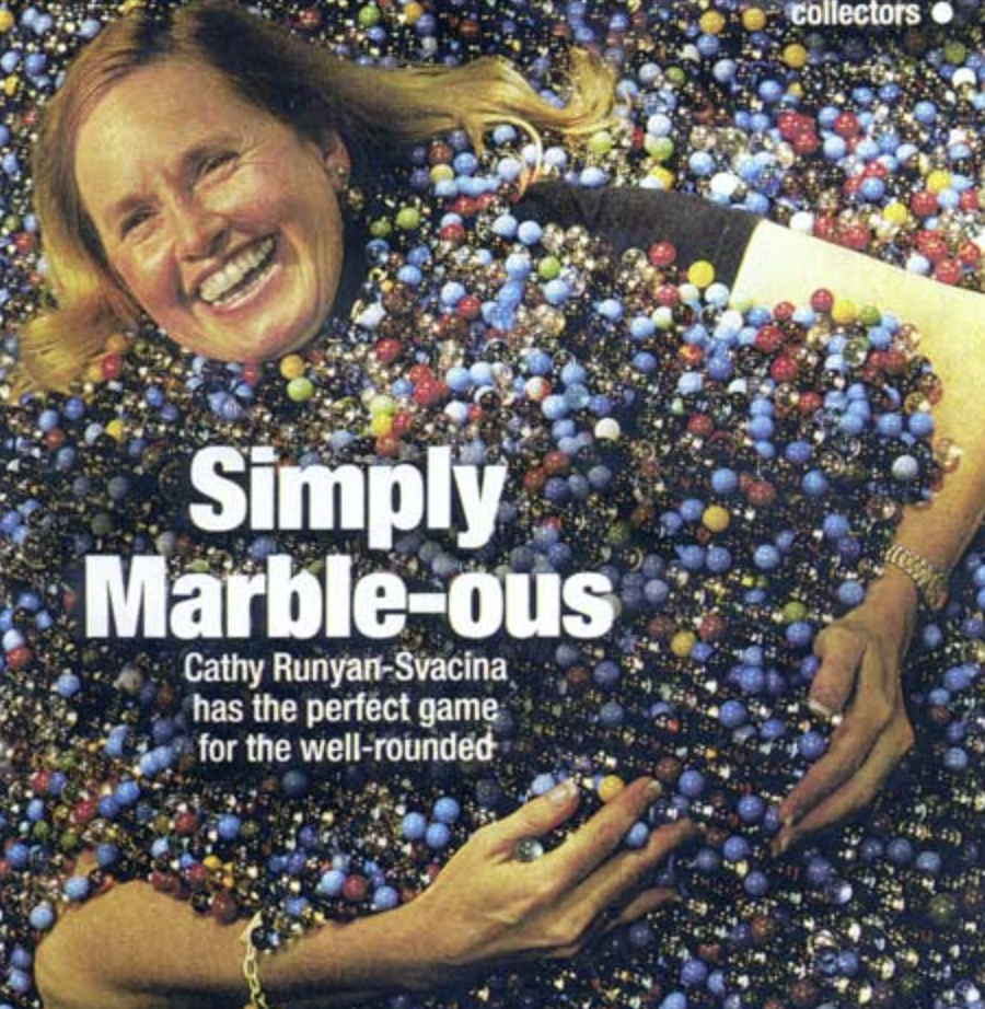 Cathy aka the Marble Lady in a pool of marbles